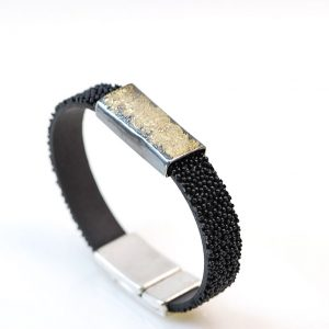 Silver  and gold 18k bracelet with ruber wrap