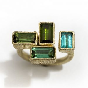 Green tourmalines 18ct gold ring