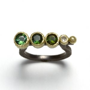 Green tourmalines &  diamonds 18ct gold and silver ring