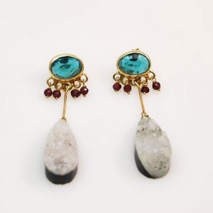 Long gold plated silver earrings with blue quartz